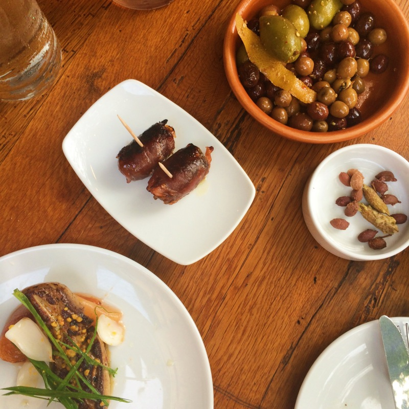 Aceitunas - Marinated olives in bay leaf, orange and spices; Datiles con Jamon - Medjool dates filled with Marcona almonds and Cabrales blue cheese, wrapped in Jamon Serrano